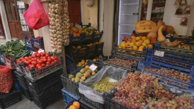 fresh produce for sale outside shop in old town corfu, greece - greece stock videos & royalty-free footage