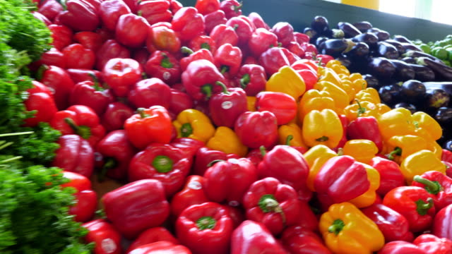 ms pan fresh produce in produce market - pepper vegetable stock videos & royalty-free footage