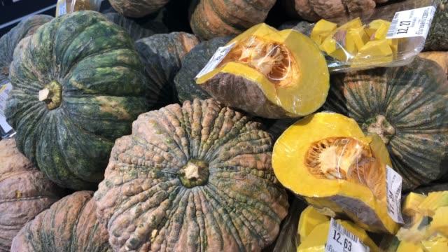 fresh pumkins on shelf - pumpkin stock videos & royalty-free footage