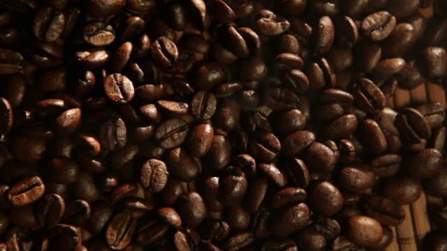fresh roasted coffee beans smoke - roasted coffee bean stock videos & royalty-free footage