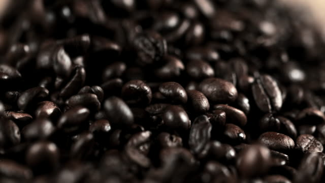 slo mo cu fresh roasted coffee beans - roasted coffee bean stock videos & royalty-free footage
