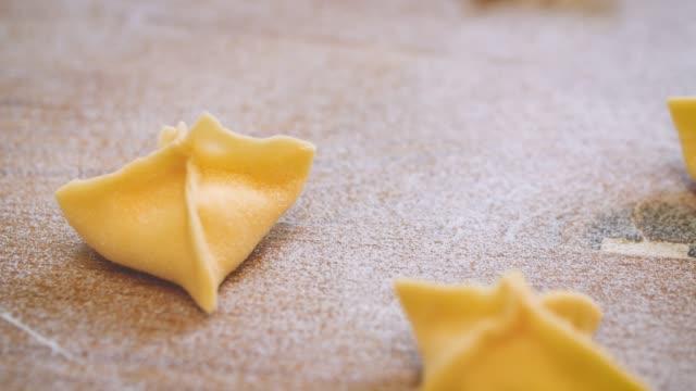 fresh sacchetti pasta on wooden surface - comfort food stock videos & royalty-free footage