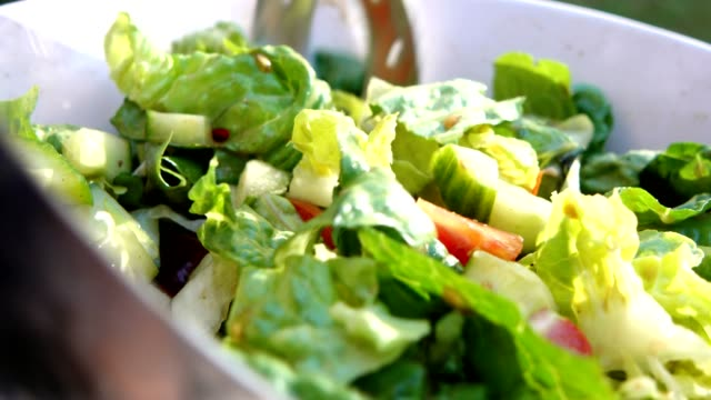 fresh salad with tomatos. - mixing stock videos & royalty-free footage