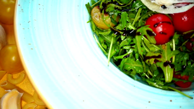fresh salad with white root, arugula and tomato - plate stock videos and b-roll footage