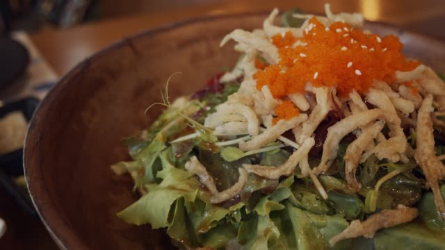 fresh salad with white small japanese fish on a wooden bowl - salad bowl stock videos & royalty-free footage