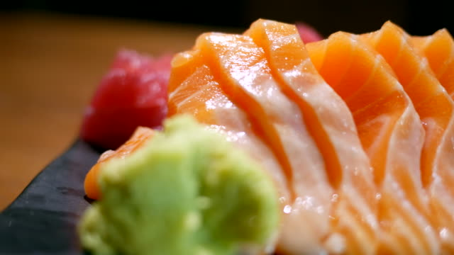 fresh salmon on table in motion - saltwater fish stock videos & royalty-free footage
