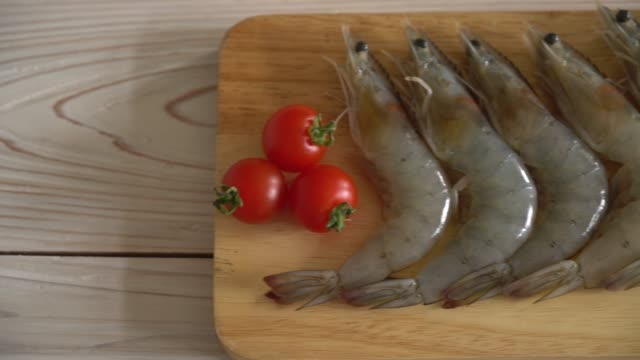 fresh shrimps on wooden board