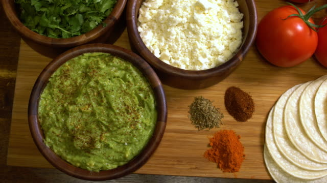 fresh side of guacamole and cotija cheese - tortilla flatbread stock videos & royalty-free footage