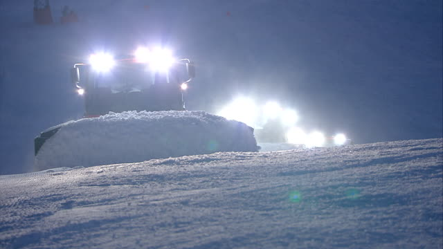 fresh snow is prepared, skiing area in italy - skipiste stock-videos und b-roll-filmmaterial