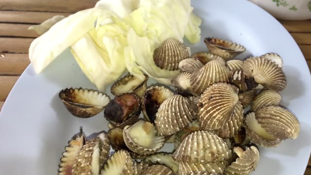 fresh steamed blanched cockle clams with spicy dipping sauce - clam seafood stock videos and b-roll footage