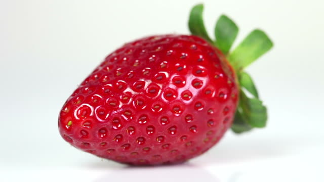 fresh strawberry - close up - weißer hintergrund stock videos & royalty-free footage