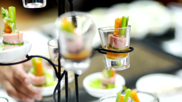 fresh tasty canape glasses on the banquet table. - ham stock videos and b-roll footage