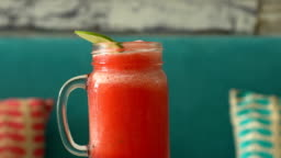 Fresh tropical organic watermelon smoothie rotate on table