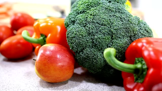 Fresh vegetables and fruit on kitchen counter.