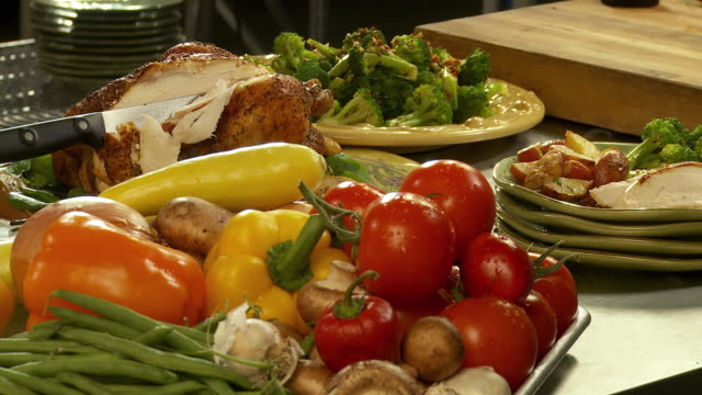 cu, fresh vegetables and roasted chicken on kitchen counter - roast chicken stock videos & royalty-free footage