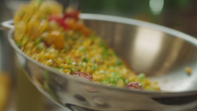 slo mo cu fresh vegetables being tossed in a skillet - herde stock-videos und b-roll-filmmaterial