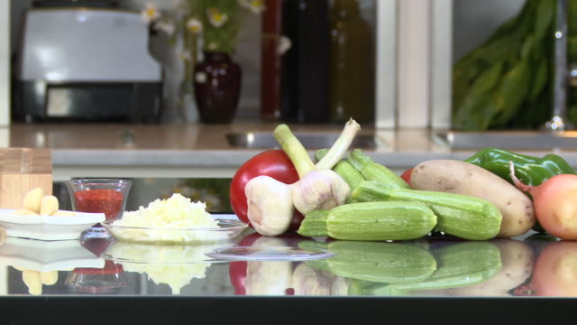 fresh vegetables. view of vegetables on a kitchen counter. - kitchen worktop stock videos & royalty-free footage