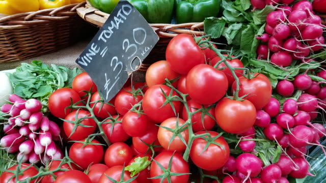 fresh vine tomatoes and garden radish on market display - price tag stock videos & royalty-free footage