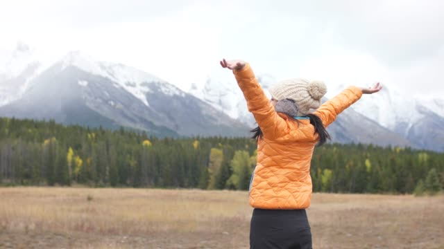 fresh woman opening arms raised freedom in winter - medallist stock videos & royalty-free footage