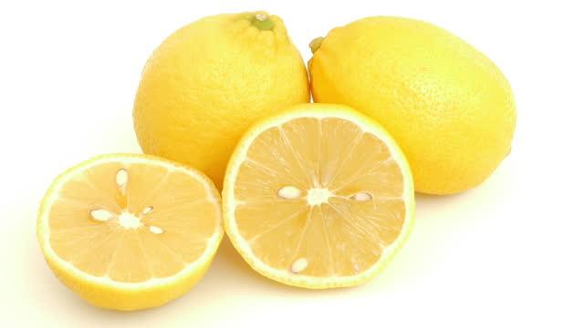 fresh yellow lemon fruits and half on white background,panning shot - slice stock videos & royalty-free footage