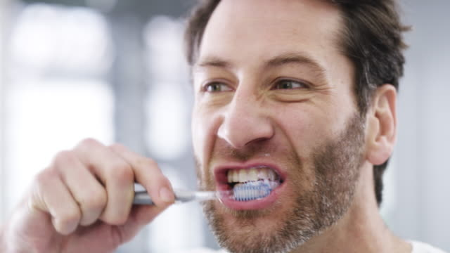 freshening up for the day ahead - brushing teeth stock videos & royalty-free footage