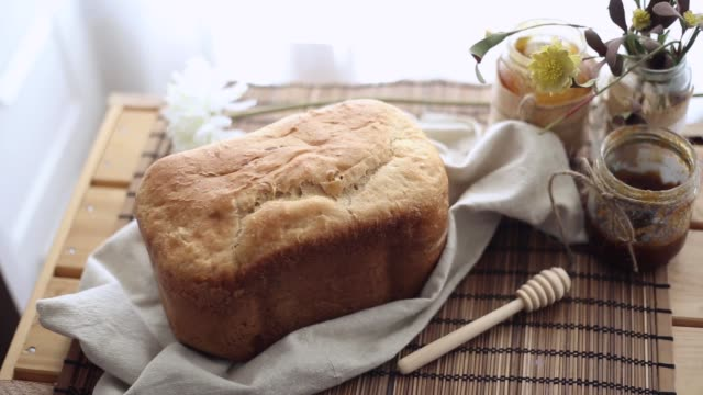 Freshly baked bread with honey