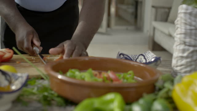 freshly chopped vegetables are heaped into an earthenware dish - pottery stock videos & royalty-free footage