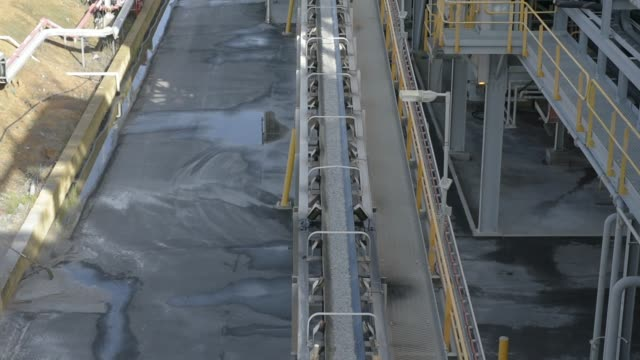 Freshly crushed lithium ore travels along a conveyor belt in the early stages of processing at a Talison Lithium Ltd facility a joint venture between...