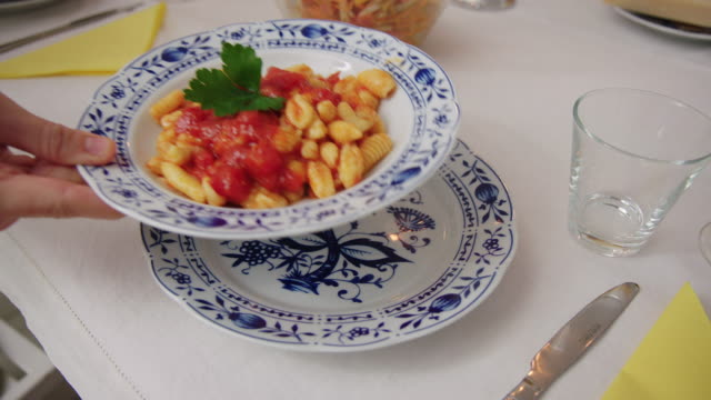 freshly made pasta served in plate on dining table - serving size stock videos & royalty-free footage