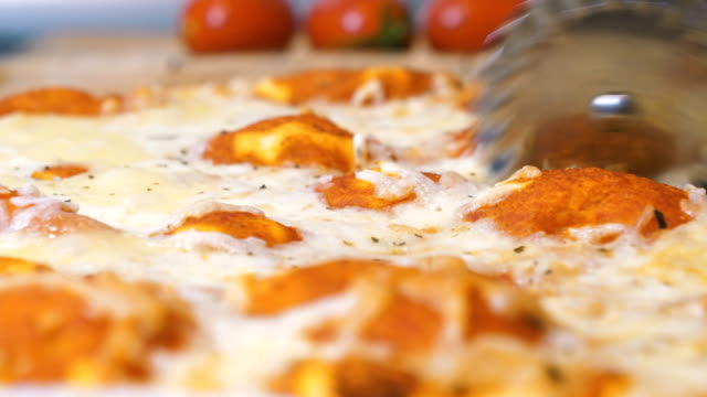 freshly made pizza - slice stock videos & royalty-free footage