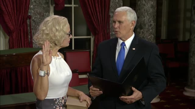 freshman arizona senator kyrsten sinema is sworn in by vice president mike pence with her hand on a bible at the historic old senate chamber on... - 忠誠点の映像素材/bロール