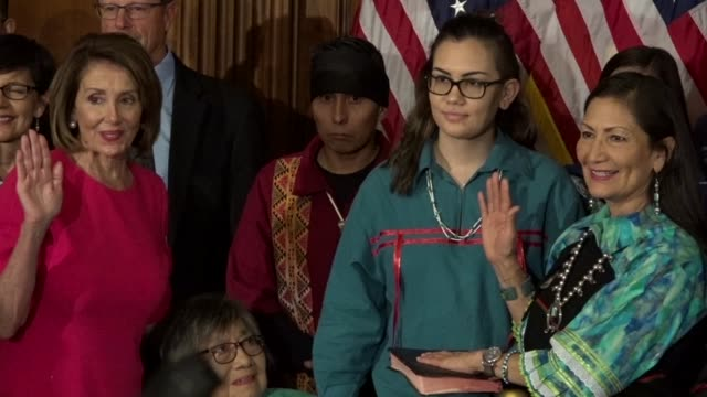 freshman new mexico congresswoman deb haaland is administered the oath of office in ceremony by house speaker nancy pelosi among family as media snap... - membro del congresso video stock e b–roll