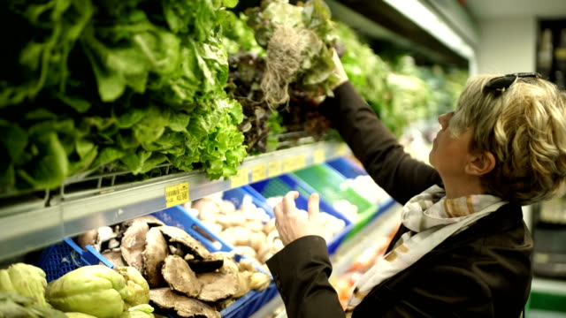 freshness,green vegetables in supermarket - 50 54 years stock videos & royalty-free footage
