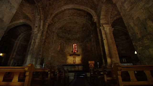 friary and church of saint john-mark. tilt down to the apse, altar and crucifix of the medieval church. - apse stock videos & royalty-free footage