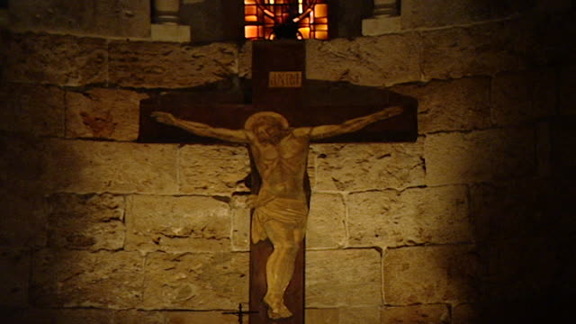 friary and church of saint john-mark. tilt up from the apse, altar and crucifix of the medieval church. - apse stock videos & royalty-free footage