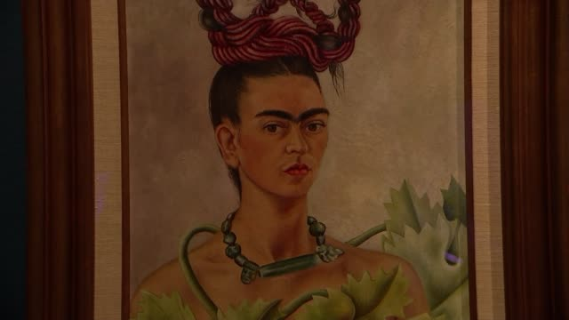 frida kahlo exhibition opens at v&a museum; england: london: victoria and albert museum : int self-portrait of frida kahlo on display at 'frida... - museum stock videos & royalty-free footage