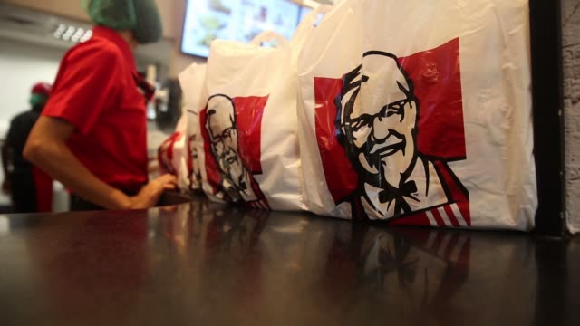 fried chicken sit in trays inside a kfc restaurant operated by yum brands inc kfc and yoma strategic holdings in yangon myanmar on thursday oct 8 an... - tablett oder küchenblech stock-videos und b-roll-filmmaterial