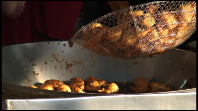 (hd1080) fried food balls being scooped out of pan - audio available stock videos & royalty-free footage
