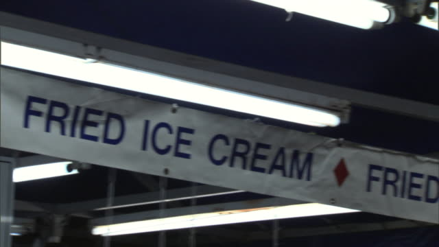 CU PAN Fried ice cream sign in amusement park at night, Dallas, Texas, USA