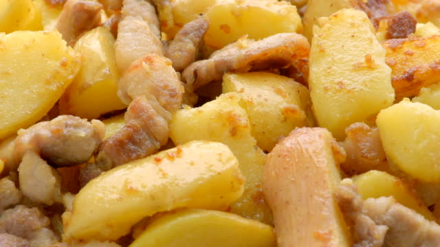 fried potato with pork cracklings - fried potato stock videos and b-roll footage