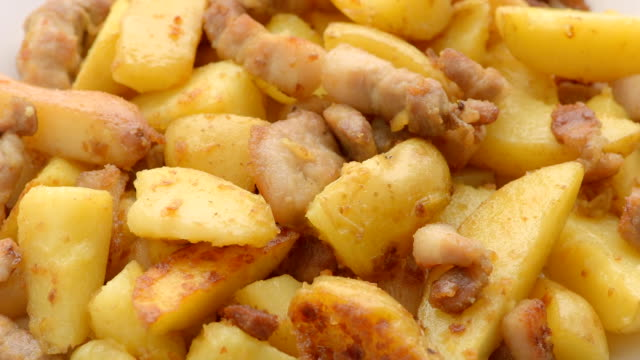 fried potato with pork cracklings - greave stock videos and b-roll footage