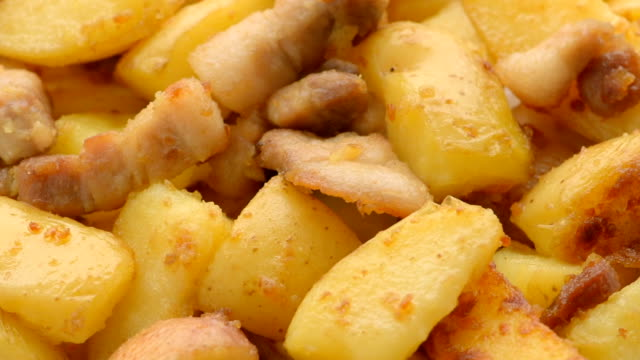 fried potatoes with pork cracklings, close up - greave stock videos and b-roll footage