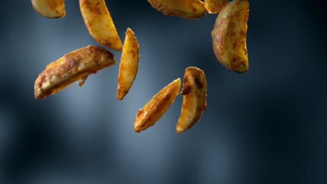 fried potatos falling - salty snack stock videos & royalty-free footage