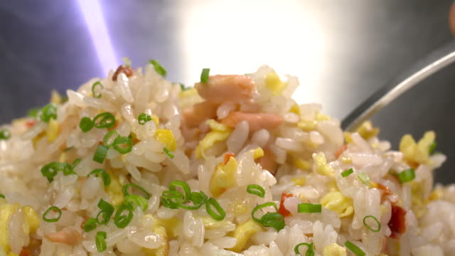 fried rice with a spoon - fried rice stock videos and b-roll footage