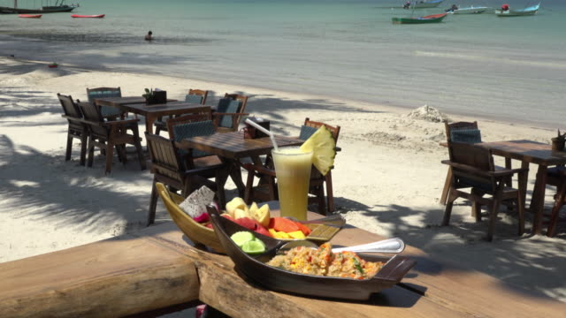 fried rice with pineapple juice and fruit salad on sandy beach - gulf of thailand stock videos & royalty-free footage