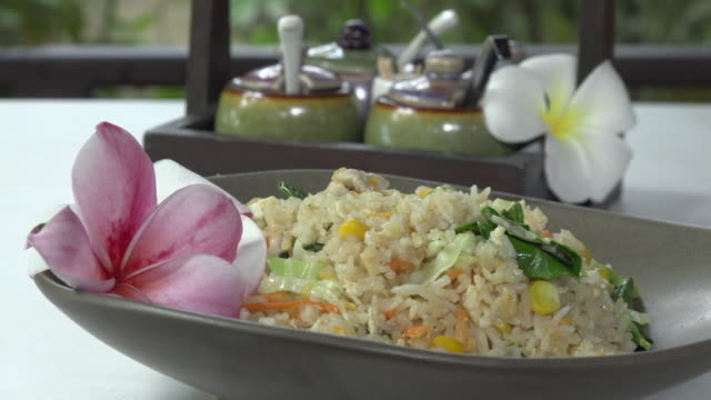fried rice with vegetables, typical thai food - fried rice stock videos and b-roll footage