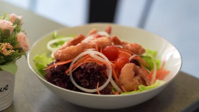 fried shrimps salad , fresh hydrophobic lettuce