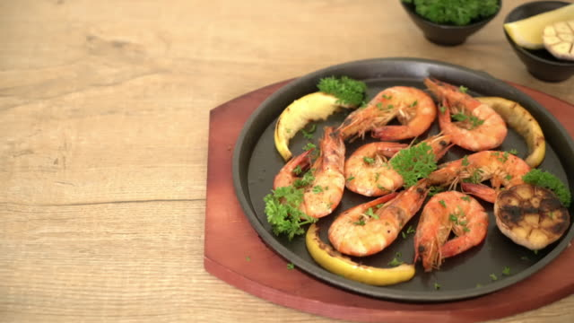 fried shrimps with garlic and lemon - parsley stock videos and b-roll footage