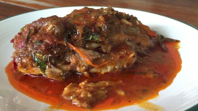fried spicy fish - meal stock videos and b-roll footage