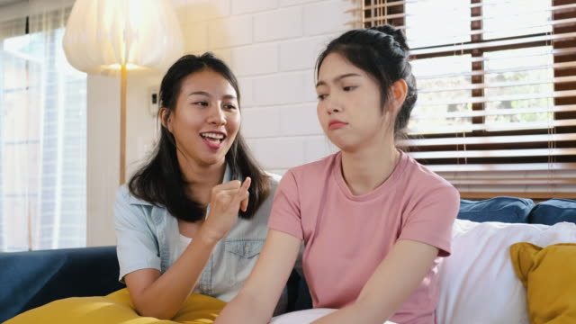 friend ask for forgiveness with her girlfriend sitting on sofa at home.lebsian lgbtq lifestyle concept - forgiveness stock videos & royalty-free footage